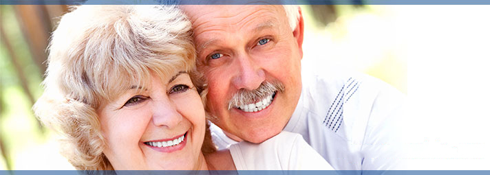 Image of two smiling retirees