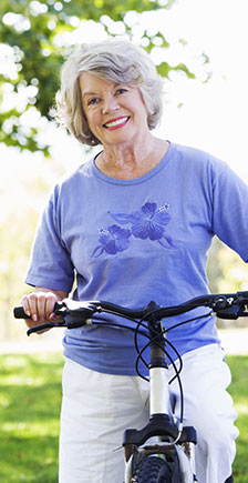 A healthy retiree cycling in the park