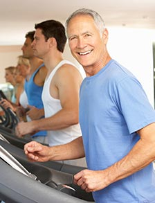 Retired man exercising on a treadmill