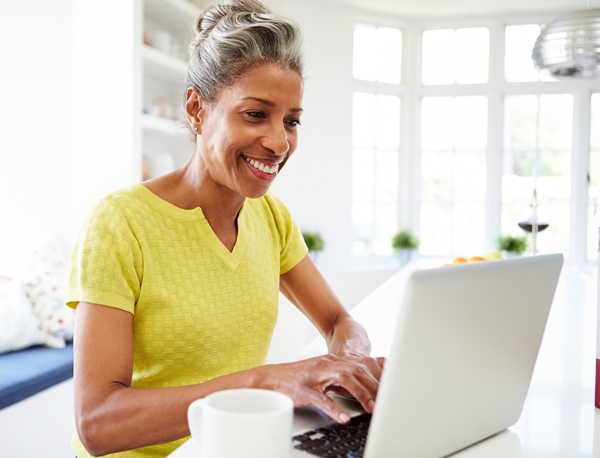 Mature woman smiling at her computer