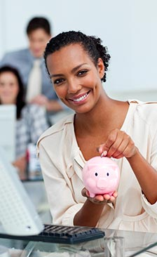 Happy woman savings money in piggy bank